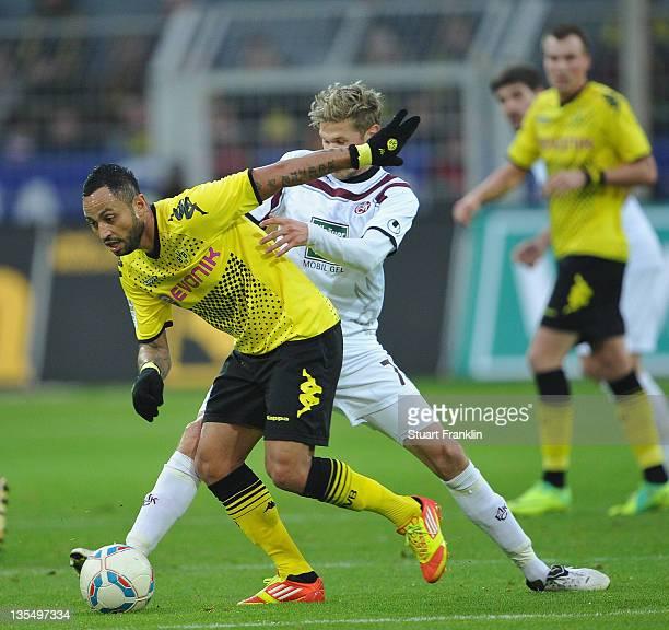 Antonio Da Silva of Dortmund challenges Oliver Kirch of Kaiserslautern during the Bundesliga match between Borussia Dortmund and 1 FC Kaiserslautern...