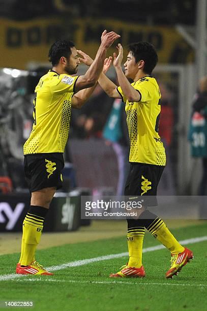 Antonio da Silva of Dortmund replaces teammate Shinji Kagawa joke during the Bundesliga match between Borussia Dortmund and FSV Mainz 05 at Signal...