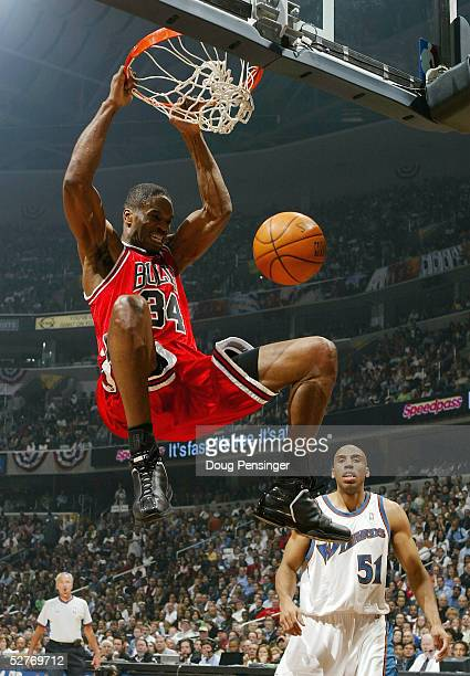 Antonio Davis of the Chicago Bulls dunks the ball in front of Michael Ruffin of the Washington Wizards in Game six of the Eastern Conference...