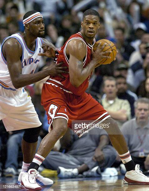 Antonio Davis of the Chicago Bulls is defended by Elton Brand of the Los Angeles Clippers during the game between the Los Angeles Clippers and the...