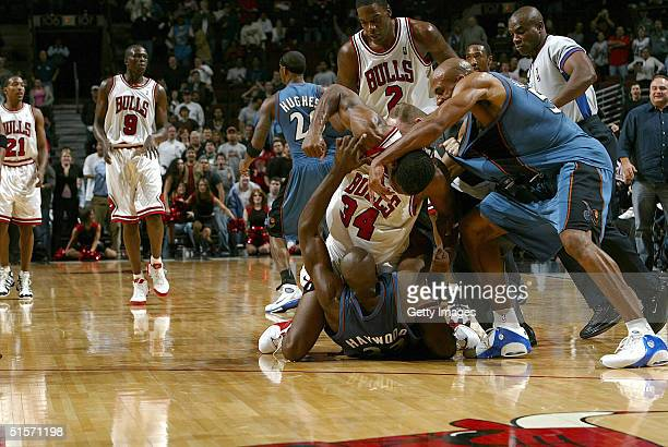 Antonio Davis of the Chicago Bulls throws a punch at Brendan Haywood of the Washington Wizards during a fight in the third quarter on October 25 2004...