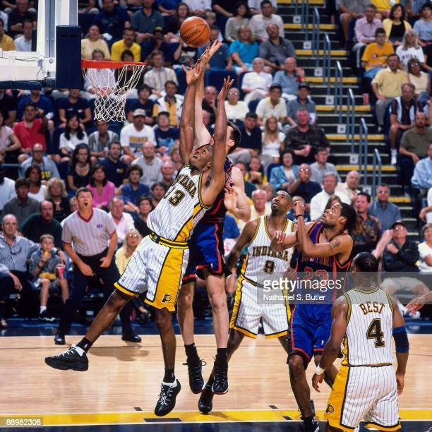 Antonio Davis of the Indiana Pacers and Chris Dudley of the New York Knicks battle for a rebound in Game One of the Eastern Conference Finals during...
