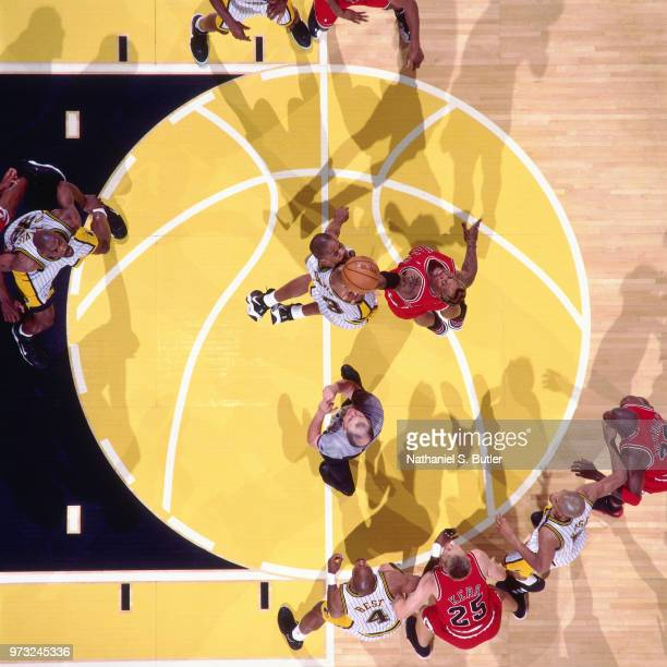 Antonio Davis of the Indiana Pacers and Dennis Rodman of the Chicago Bulls reach for the jumpball during a game played on May 29 1998 at the Market...