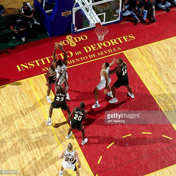 Antonio Davis of the Indiana Pacers goes up for a shot against Larry Stewart of the Seattle SuperSonics during the 1996 NBA Europe Tour October 20...