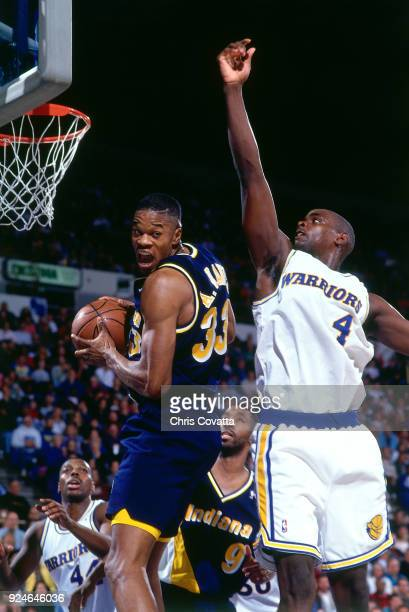 Antonio Davis of the Indiana Pacers rebounds during a game played on December 4 1993 at the Arena in Oakland in Oakland California NOTE TO USER User...