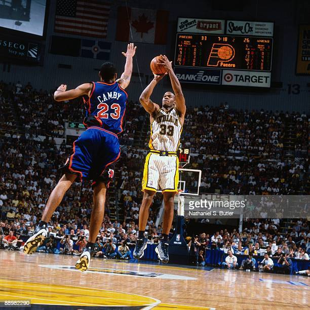Antonio Davis of the Indiana Pacers shoots a jump shot against Marcus Camby of the New York Knicks in Game Five of the Eastern Conference Finals...