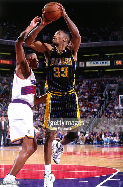 Antonio Davis of the Indiana Pacers shoots against the Phoenix Suns during a game played on December 7 1997 at America West Arena in Phoenix Arizona...
