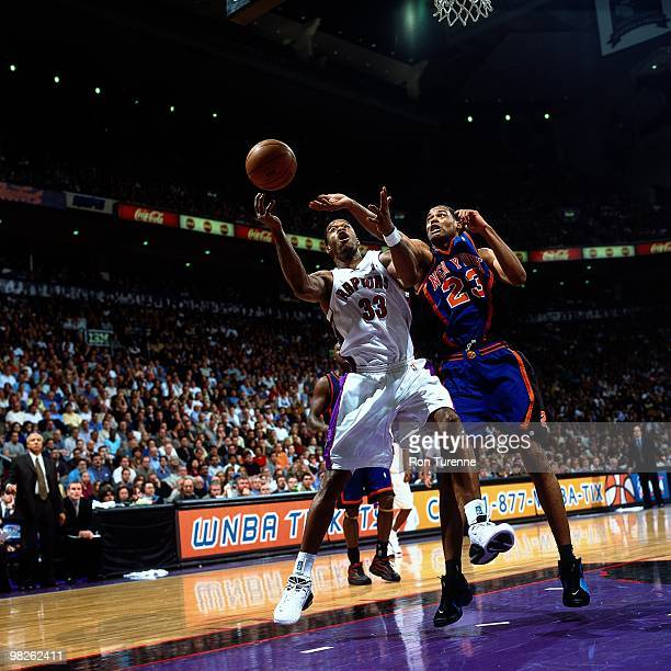 Antonio Davis of the Toronto Raptors battles for the loose ball against the New York Knicks during a game played in 2001 at Air Canada Centre in...