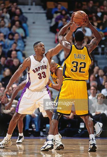 Antonio Davis of the Toronto Raptors defends against Dale Davis of the Indiana Pacers on December 14 1999 at the Air Canada Centre in Toronto Ontario...