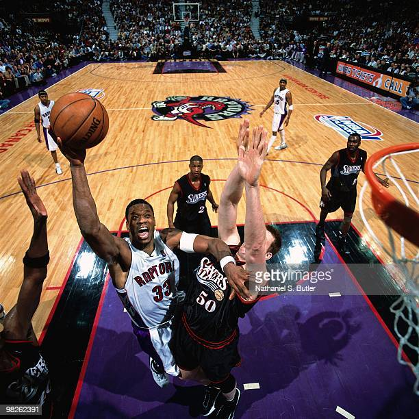 Antonio Davis of the Toronto Raptors dunks against the Philadelphia 76ers during a game played in 2001 at the Air Canada Centre in Toronto Canada...