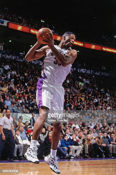 Antonio Davis of the Toronto Raptors rebounds against the New Jersey Nets on December 21 1999 at the Air Canada Centre in Toronto Ontario Canada NOTE...