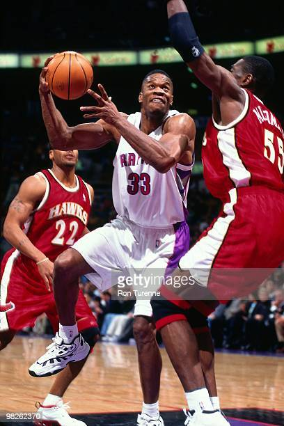 Antonio Davis of the Toronto Raptors shoots against the Atlanta Hawks during a game played in 2000 at the Air Canada Centre in Toronto Canada NOTE TO...