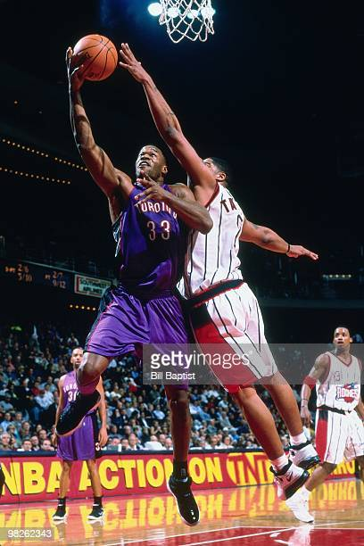 Antonio Davis of the Toronto Raptors shoots against the Houston Rockets during a game played in 2001 at the Compaq Center in Houston Texas NOTE TO...