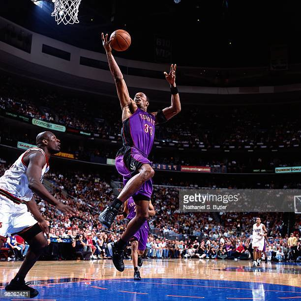 Antonio Davis of the Toronto Raptors shoots against the Philadelphia 76ers during a game played in 2001 at the Wachovia Center in Philadelphia...