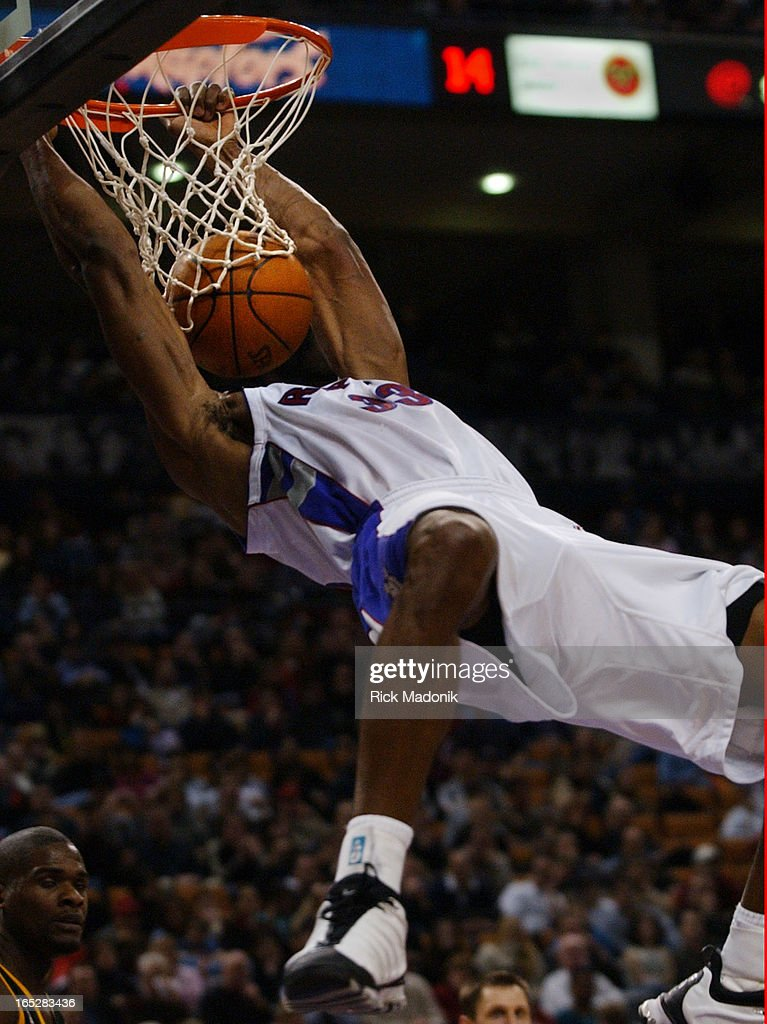 IMAGE - 02/24/02 - TORONTO, ONTARIO - Antonio Davis seems to have replaced his head with the ball following a dunk during NBA matchup between the Toronto Raptors and Seatle Supersonics at the Air Canada Centre Sunday evening.