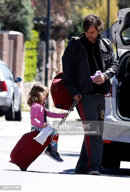 Part of this image has been pixellated to obscure the identity of the child Antonio de la Rua and his daughter Zulu de la Rua are seen on May 1 2016...