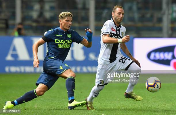 Antonio Di Gaudio of Parma Calcio competes for the ball with Jens Stryger Larsen of Udinese Calcio during the serie A match between Parma Calcio and...