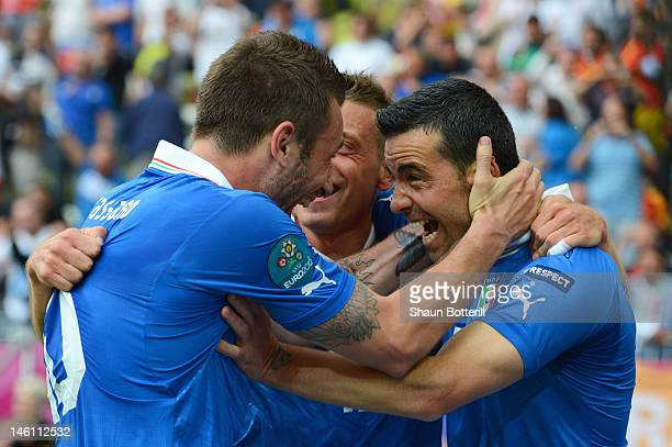 Antonio Di Natale of Italy celebrates scoring their first goal with Antonio Cassano during the UEFA EURO 2012 group C match between Spain and Italy...