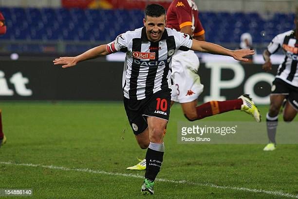 Antonio Di Natale of Udinense Calcio celebrates after scoring their third goal from the penalty spot during the Serie A match between AS Roma and...