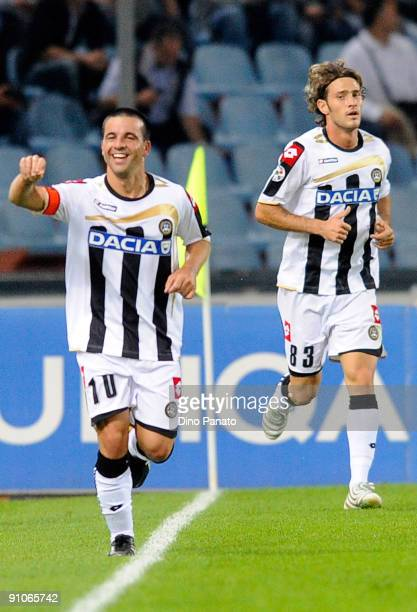 Antonio Di Natale of Udinese Calcio celebrates after scores the first goal during the serie A match between Udinese Calcio and AC Milan at Stadio...