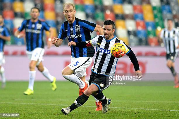 Antonio Di Natale of Udinese Calcio competes with Andrea Masiello of Atalanta BC during the TIM Cup match between Udinese Calcio and Atalanta BC at...