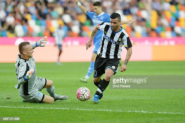 Antonio Di Natale of Udinese Calcio competes with Lukasz Skorupski goalkeeper of Empoli FC during the Serie A match between Udinese Calcio v Empoli...
