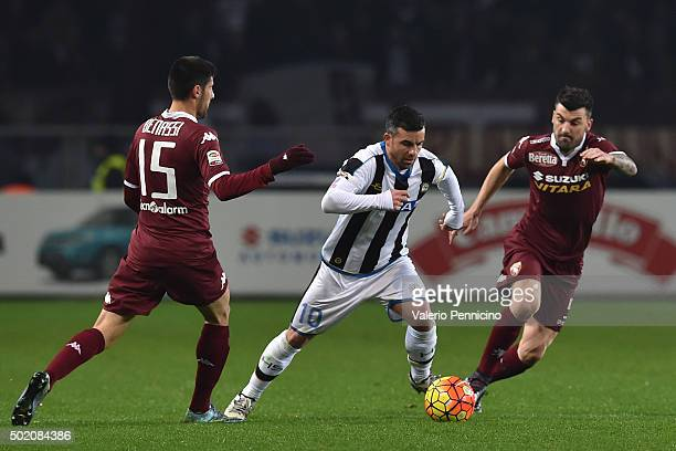 Antonio Di Natale of Udinese Calcio in action against Marco Benassi and Cesare Bovo of Torino FC during the Serie A match between Torino FC and...