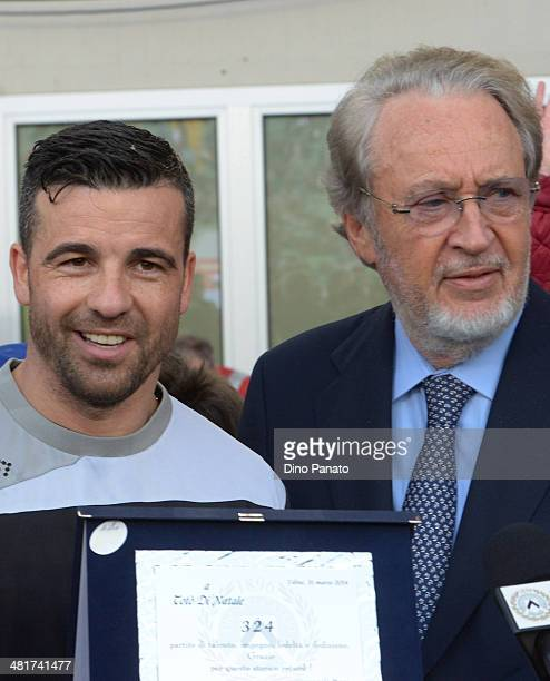 Antonio Di Natale of Udinese Calcio receives a plaque from Gianpaolo Pozzo president of Udinese Calcio before the Serie A match between Udinese...