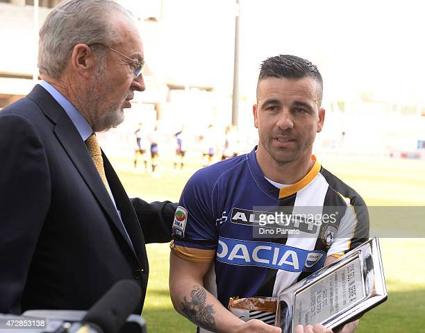 Antonio Di Natale of Udinese Calcio receives placque to Gianpaolo Pozzo for his 206 Goal in serie A before the Serie A match between Udinese Calcio...