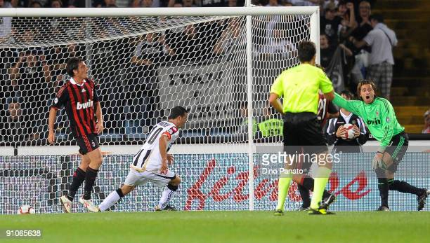 Antonio Di Natale of Udinese Calcio scores the first goal during the serie A match between Udinese Calcio and AC Milan at Stadio Friuli on September...