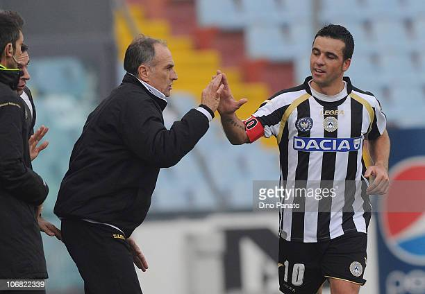 Antonio Di Natale of Udinese celebrates his 2-0 goal with coach Francesco Guidolin during the Serie A match between Udinese and Lecce at Stadio...