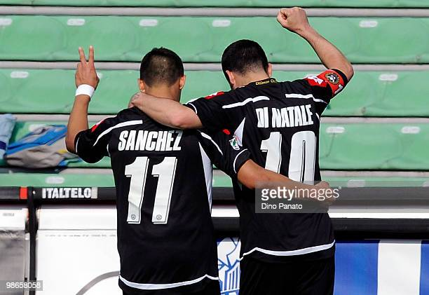 Antonio Di Natale of Udinese celebrates with team mate Alexis Alejandro Sanchez after scoring his team's fourth goal during the Serie A match between...