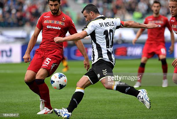 Antonio Di Natale of Udinese competes with Luca Rossettini of Cagliari during the Serie A match between Udinese Calcio and Cagliari Calcio at Stadio...