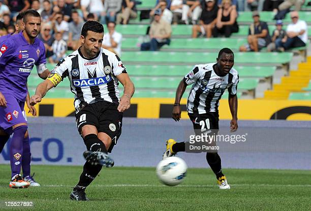 Antonio Di Natale of Udinese scores a penalty during the Serie A match between Udinese Calcio and ACF Fiorentina at Stadio Friuli on September 18,...