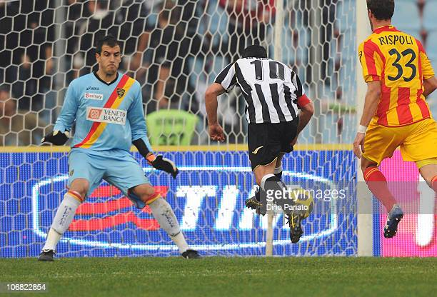 Antonio Di Natale of Udinese shoots to score past Lecces's goalkeeper Antonio Rosati during the Serie A match between Udinese and Lecce at Stadio...