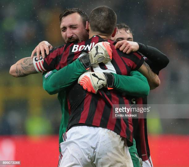 Antonio Donnarumma of AC Milan celebrates the victory with his teammate Leonardo Bonucci at the end of the TIM Cup match between AC Milan and FC...