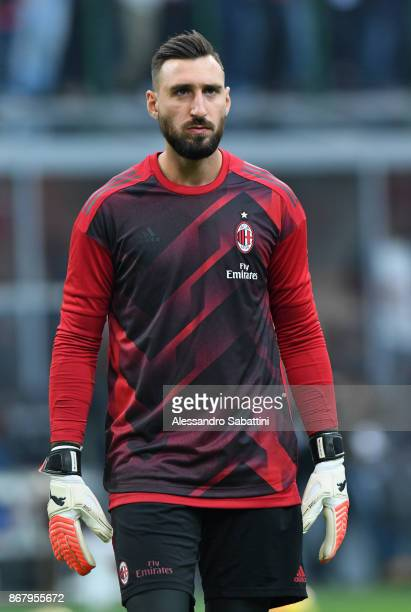 Antonio Donnarumma of AC Milan warms up before the Serie A match between AC Milan and Juventus at Stadio Giuseppe Meazza on October 28 2017 in Milan...
