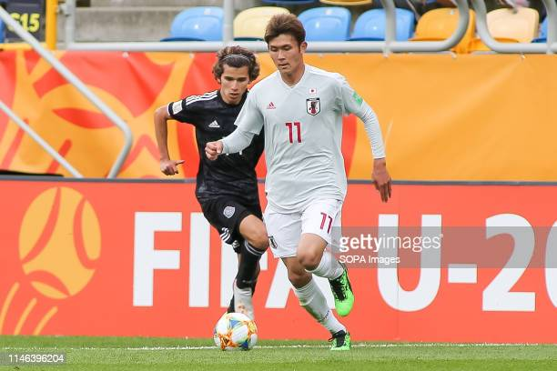 Antonio Figueroa from Mexico and Kyosuke Tagawa from Japan are seen in action during the FIFA U-20 World Cup match between Mexico and Japan in...