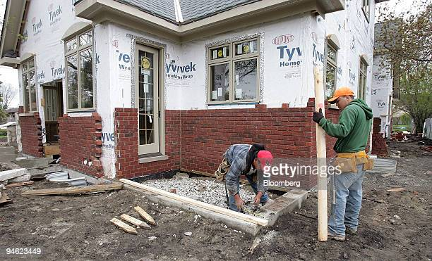 Antonio Flores left and Misaal Carbajal work on a new home under construction in Park Ridge Illinois Friday April 27 2007 The US economy grew last...