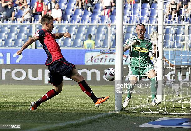 Antonio Floro Flores of Genoa CFC scores past goalkeeper Alex Calderoni of AC Cesena during the Serie A match between Genoa CFC and AC Cesena at...