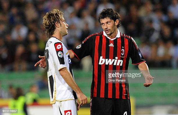 Antonio Floro Flores of Udinese arguing with Kakha Kaladze of AC Milan during the serie A match between Udinese Calcio and AC Milan at Stadio Friuli...