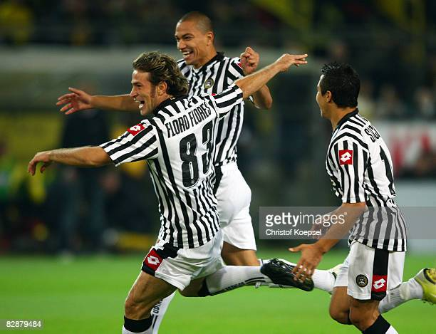 Antonio Floro Flores of Udinese celebrates the first goal with Goekhan Inler and Alexis Sanchez R9 during the UEFA Cup first round first leg match...