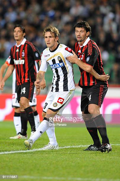 Antonio Floro Flores of Udinese is restrained by Kakha Kaladze of AC Milan during the serie A match between Udinese Calcio and AC Milan at Stadio...