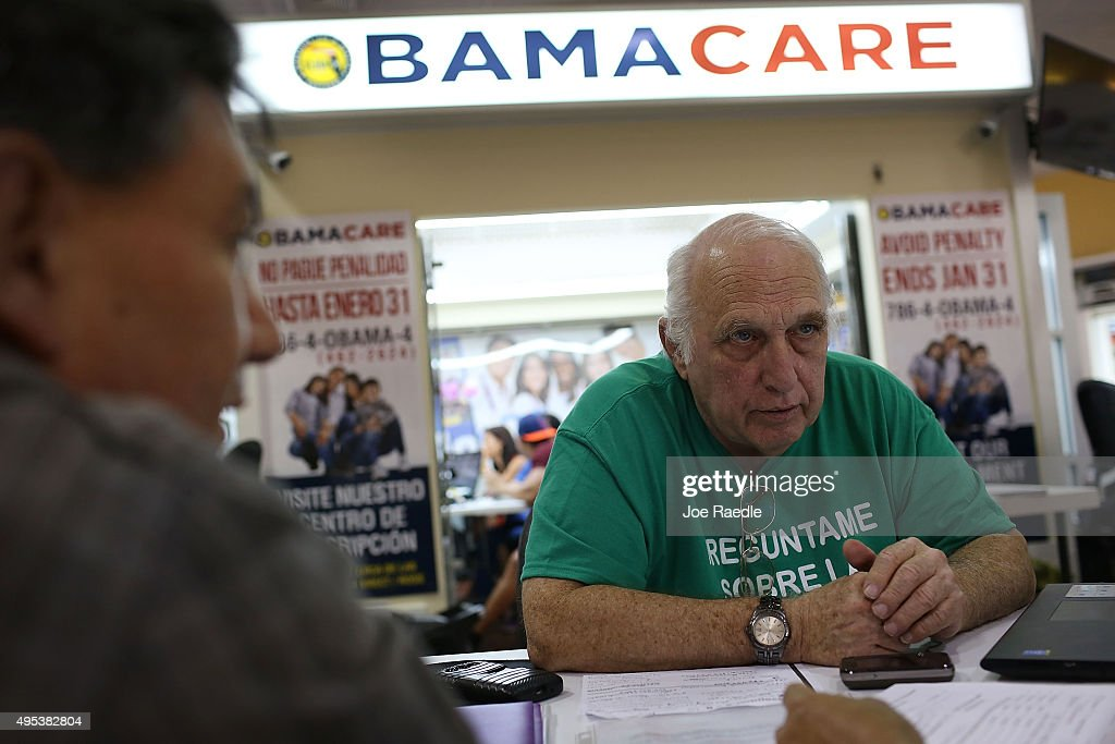 Antonio Galis, an insurance agent from Sunshine Life and Health Advisors, discusses with a client plans available in the third year of the Affordable Care Act at a store setup in the Mall of the Americas on November 2, 2015 in Miami, Florida. Open Enrollment began yesterday for people to sign up for a 2016 insurance plan through the Affordable Care Act.