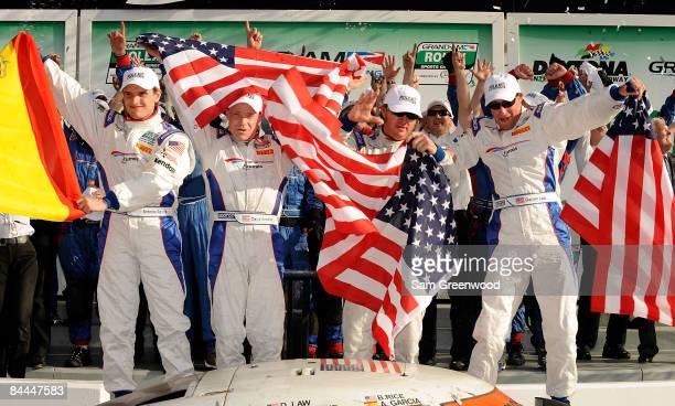Antonio Garcia David Donahue Buddy Rice and Darren Law drivers of the Brumos Porsche Riley celebrate after winning the Rolex 24 at Daytona...