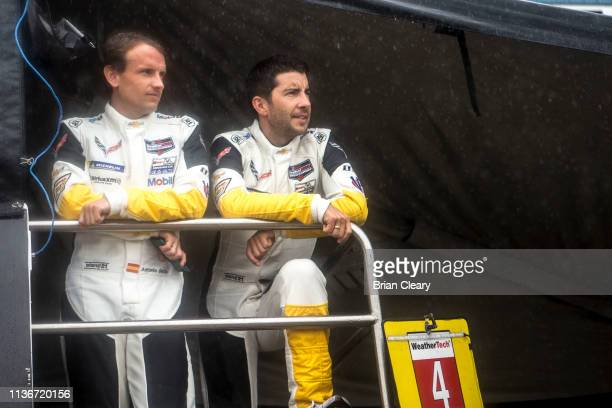 Antonio Garcia L of Spain and Mike Rockefeller of Germany look out over the gird before the12 Hours of Sebring at Sebring International Raceway in...