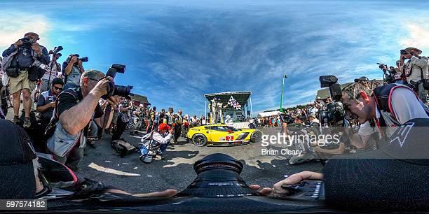 Antonio Garcia left of Spain and Jan Magnussen of Denmark celebrate after winning the IMSA WeatherTech Series race at Virginia International Raceway...