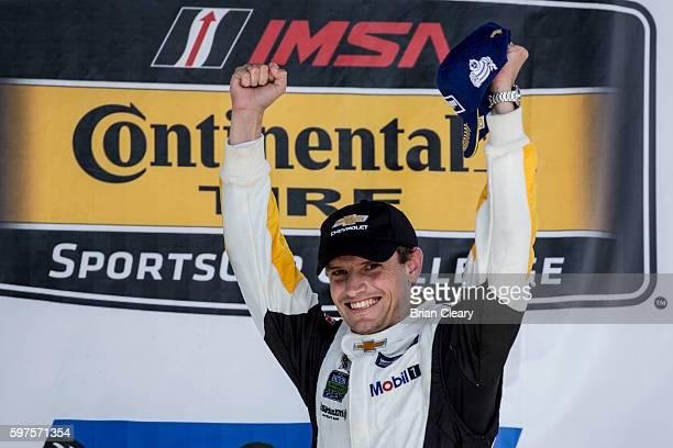 Antonio Garcia of Spain celebrates after winning the IMSA WeatherTech Series race at Virginia International Raceway on August 28 2016 in Alton...