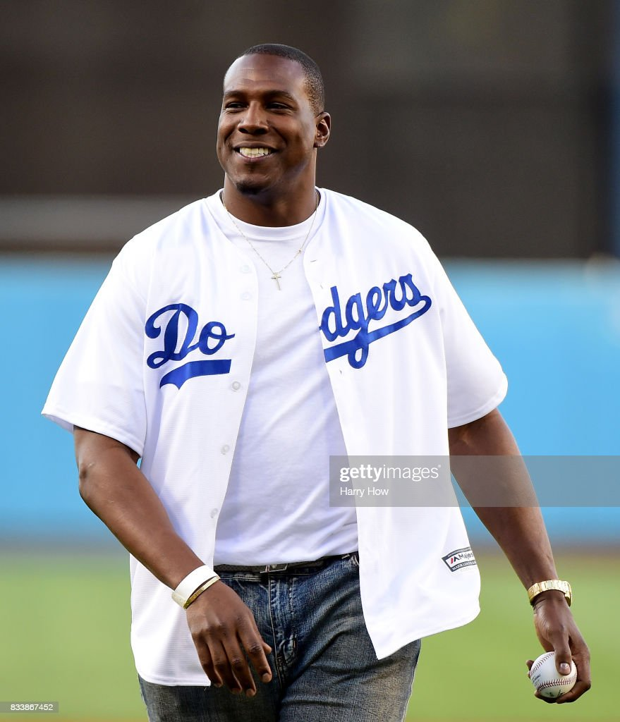 Antonio Gates of the Los Angeles Chargers reacts after throwing out a ceremonial first pitch before the game between the New York Mets and the Los Angeles Dodgers at Dodger Stadium on June 22, 2017 in Los Angeles, California.