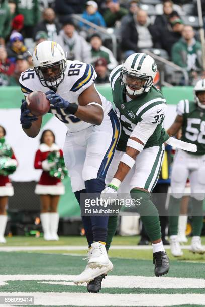 Antonio Gates of the Los Angeles Chargers scores a first half touchdown reception under pressure from Jamal Adams of the New York Jets in an NFL game...